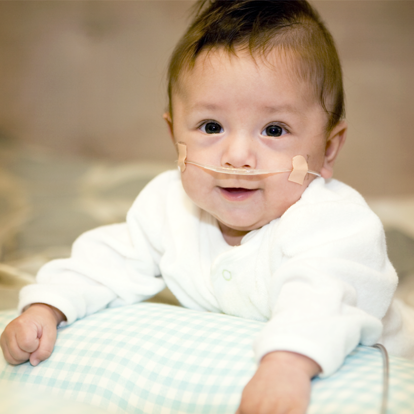 Happy baby with medical needs