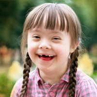 Girl with down syndrome smiling