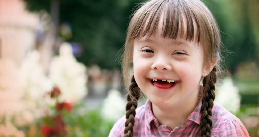 A smiling girl with down syndrome.